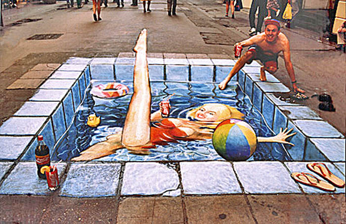 The same pavement drawing viewed this time from the correct perspective reveals a girl in a red swimsuit lying in a swimming pool.