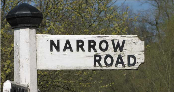 "Photo of an old wooden road sign with 'narrow road' on it ""The way is narrow that leads to life, and there are few who find it."" Mt 7:14"